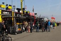 One view of some haulers lined up across the pavement from the garage.