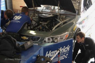 Mechs busy tuning up #88 for Dale Earnhart Jr. between practice runs.